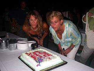 [Jamie Reynolds Conerty and Wendy Meninno blowing candles picture]